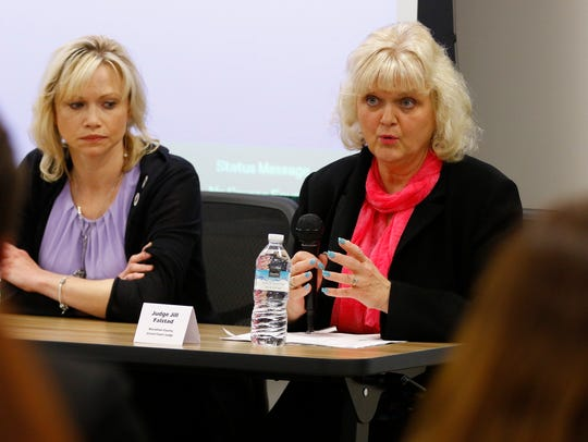 Judge Jill Falstad talks about Marathon County's response to domestic violence at a 2017 panel discussion at the Wausau library.