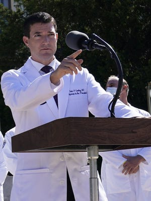 Dr. Sean Conley, physician to President Donald Trump, briefs reporters Saturday at Walter Reed National Military Medical Center in Bethesda, Md.