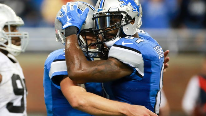 Lions QB Matthew Stafford and WR Calvin Johnson embrace after defeating the Oakland Raiders, 18-13, Sunday at Ford Field.