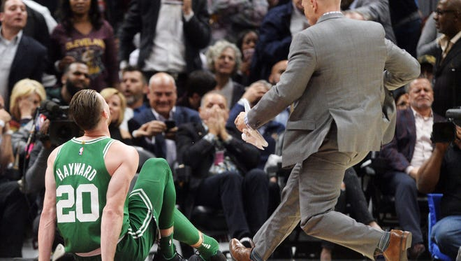 Boston Celtics forward Gordon Hayward (20) sits on the court Tuesday night after injuring his ankle during the first half against the Cleveland Cavaliers at Quicken Loans Arena.
