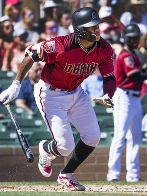 Ketel Marte of the Arizona Diamondbacks hits a double in the third inning against the Colorado Rockies at Salt River Fields at Talking Stick, Monday, March 12, 2018.