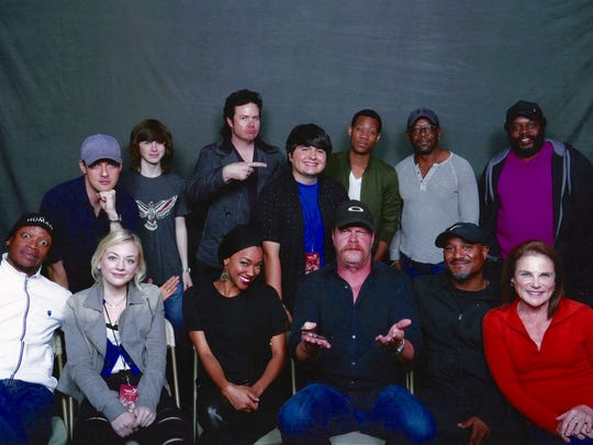 "Lincoln Castellanos, (center top row) is surrounded by cast mem bers of ""The Walking Dead."""