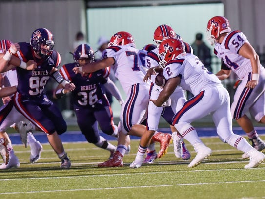 Running back Justin Guidry takes the handoff as Teurlings
