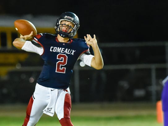 Brett Dotson drops back to pass as the Comeaux Spartans