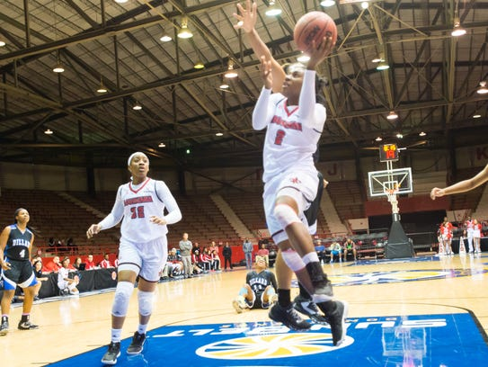 UL freshman guard Jasmine Thomas takes the ball to