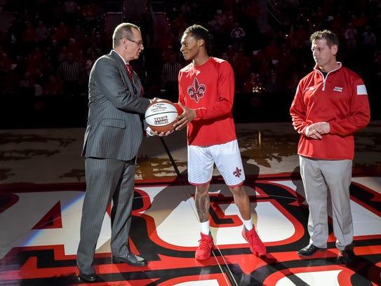 UL coach Bob Marlin presents senior Jay Wright with
