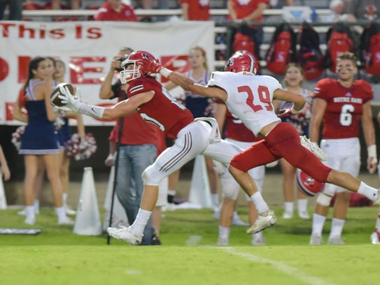 Wide Receiver Gentry Borill makes a diving catch for