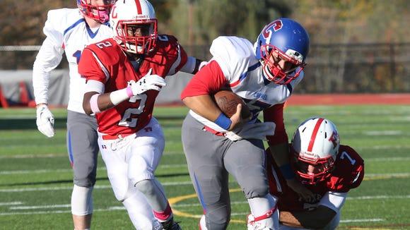 Carmel quarterback Joe Rodriguez gains some yards,