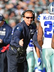 Dallas Cowboys head coach Jason Garrett celebrates