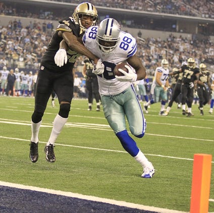 Dallas Cowboys wide receiver Dez Bryant (88) scores a fourth quarter touchdown, as New Orleans Saints cornerback Keenan Lewis (28) hangs on, on Sunday, Sept. 28, 2014, at AT&T Stadium in Arlington, Texas. (Ron T. Ennis/Fort Worth Star-Telegram/MCT via Getty Images)