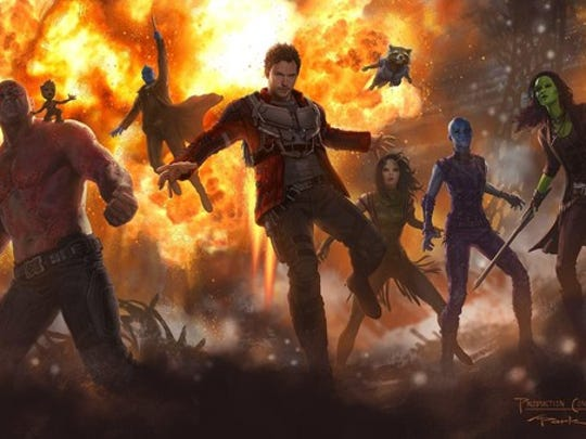 """Characters from """"Guardians of the Galaxy 2"""" standing in front of an explosion."""