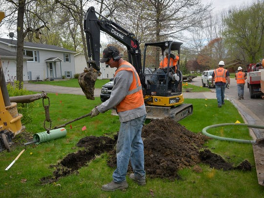 MP Nexlevel drill operator Chad Herman finishes up after pulling communications cable through the pathway he drilled Tuesday, May 3, in Annandale. Midcontinent Communications is bringing faster Internet as well as phone and cable television to the city.