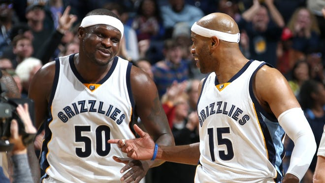 Memphis Grizzlies Zach Randolph and Vince Carter celebrate Carter's end of the third quarter buzzer beater against the Utah Jazz.
