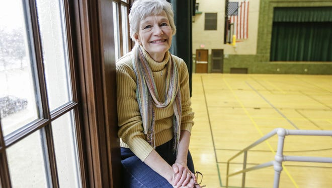 Judy Goodchild poses for a portrait in the J.E. Hamilton Community House gym March 31 in Two Rivers. The building's renovation was one of her favorite accomplishments.