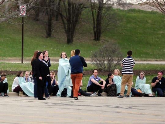 Kohl's employees wait in the outer parking area Sunday