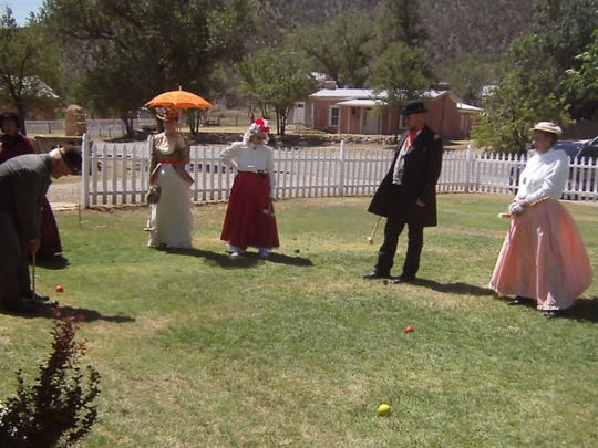 """Dressed in 1880s """"daytime"""" costumes, Cameo Ladies and Gents play croquet on the lawn of Lincoln's historic Wortley Hotel."""
