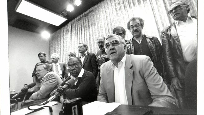 The UAW bargaining team, including Owen Bieber and Marc Stepp, discuss the settlement between the union and Chrysler on Oct. 24, 1985.