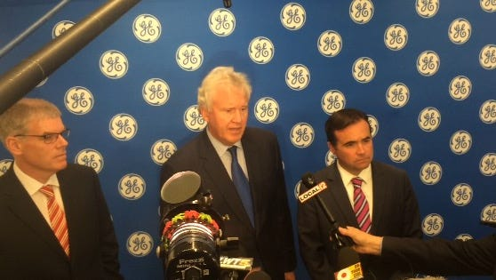 (Left to right) Shane Fitzsimons, Jeffrey Immelt and John Cranley answer questions from media following a press conference Tuesday, Oct. 25, 2016 at General Electric Co.'s Global Operations Center at The Banks in Downtown Cincinnati.