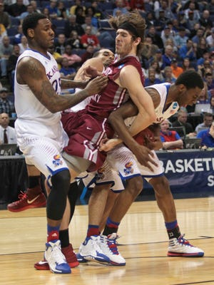 EKU's Eric Stutz tussled with Kansas' Andrew Wiggins in the second half in the NCAA second round game in St. Louis, Mo. March 21, 2014.