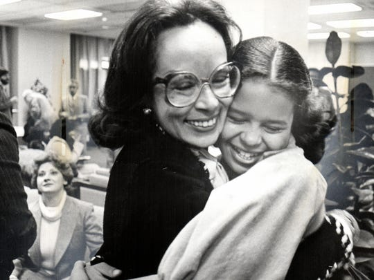 Federal Judge Anna Diggs-Taylor  gets a congratulatory hug from her then 12-year-old daughter Carla at a reception after her swearing-in ceremony in 1979 at the U.S. Courthouse in Detroit. Well-wishers included former U.N. Ambassador Andrew Young, Detroit Mayor Coleman Young, and Michigan Secretary of State Richard Austin. Taylor died over the weekend at age 84.