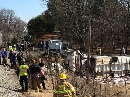 This photo provided by Rep. Greg Walden, R-Oregon, shows a crash site near Crozet, Va., on Jan. 31, 2018.   A chartered train carrying dozens of GOP lawmakers to a Republican retreat in West Virginia struck a garbage truck south of Charlottesville on Wednesday, lawmakers said.