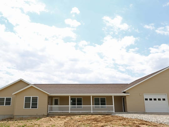 The Spece home, located in rural Buchanan County, on Wednesday, April 29, 2015. The home was recently completed, with fund-raising help from the community. Special accommodations make it easier for Sue to care for her three children with spinal muscular atrophy.