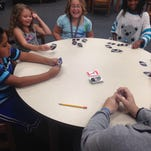 Students play a card game at the Fairview Unit of the Boys & Girls Clubs of Wayne County.