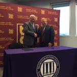 Henderson and Bateman sign the 5 memorandums of understanding.
