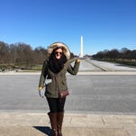 Michele Kerns stands in front of the Lincoln Memorial in Washington, D.C. The Washington Monument can be seen in the background.