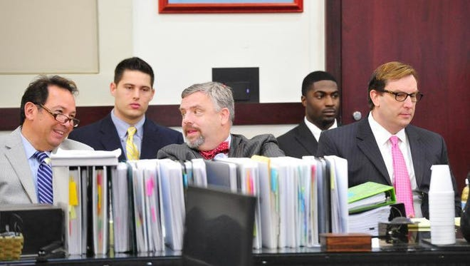 Attorneys Albert Perez Jr., front row from left, Fletcher Long and Worrick Robinson listen during the third day of the Vanderbilt rape case Wednesday in the Justice A. A. Birch Building in Nashville. Defendants Brandon Vandenburg, left in back row, and Cory Batey also listen to the day's proceedings.
