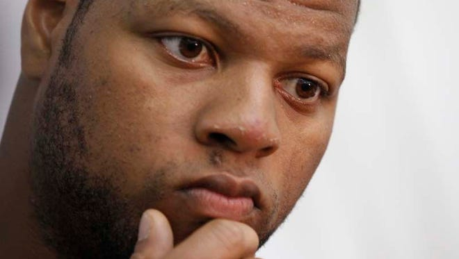 Detroit Lions Ndamukong Suh listens to a question during post practice press conference with the media after the team's OTA practice at the Lions training facilities in Allen Park on Wednesday May 21, 2014.