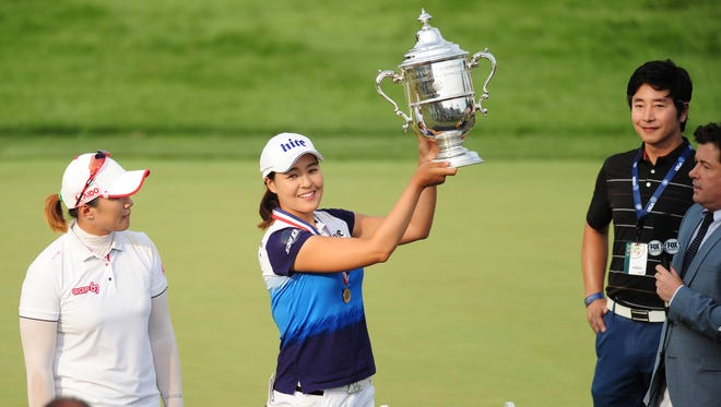 In Gee Chun holds up the trophy after the final round of the U.S. Women's Open at Lancaster Country Club.