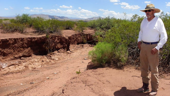 Otero County resident Franklin Herrera stands next to an arroyo near Coyote Canyon Road on his property.