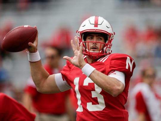 Nebraska quarterback Tanner Lee throws during warmups