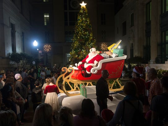 A large crowd gathers around Santa Claus at the kickoff for Winterfest. The annual event has special treats in store through Christmas Eve.