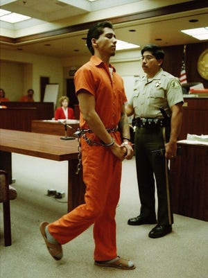 Ernesto Martinez, then 19, is led out of a Riverside Courtroom on Sept. 8, 1995.