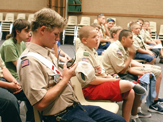 Deming Boy Scouts listen to planning stages for Wednesday's Focus on Family Pie and Ice Cream Social free community event.