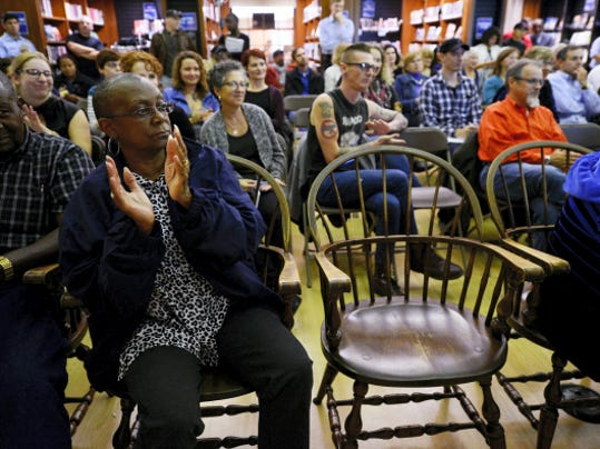 Community members clap in response to comments by Rep. Kevin Schreiber during a Fixing York: Community Conversation at Martin Library in York on Tuesday. The goal of Fixing York, which began as a Facebook group, is to find solutions to issues facing York and make it a better place.