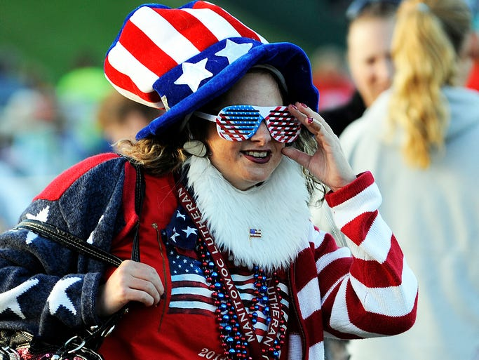 Neysa Behnke of Two Rivers is dressed in patriotic fashion in Two Rivers for the annual Independence Day festivities on Friday, July 4, 2014. Matthew Apgar/HTR Media