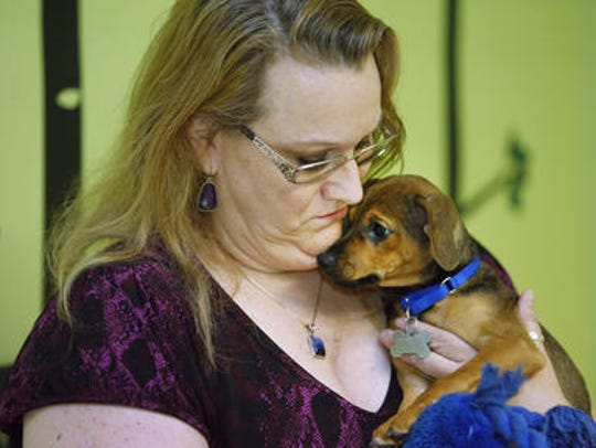 "Attorney Lisa Kiser comforts ""Rasin"" at Lost Our Home"