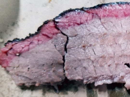 An up close look of brisket at Chester White's barbecue. The bark was flavorful and the smoke ring, which denotes a proper cooking method, was perfect.