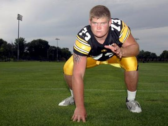 Former Iowa offensive lineman Marshal Yanda poses for a photo during the team's media day on Aug. 7, 2004. Yanda retired this week after 13 years in the NFL with the Baltimore Ravens.