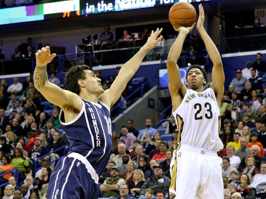 New Orleans Pelicans forward Anthony Davis (23) shoots over Oklahoma City Thunder center Steven Adams (12) during the second half of a game at the Smoothie King Center. The Thunder defeated the Pelicans 102-91.