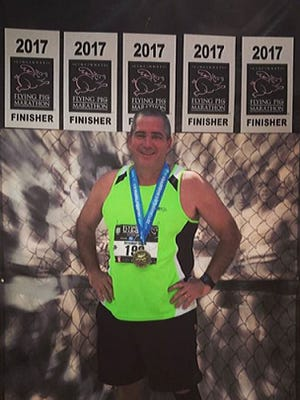 Mark Wehry completes the Flying Pig marathon.