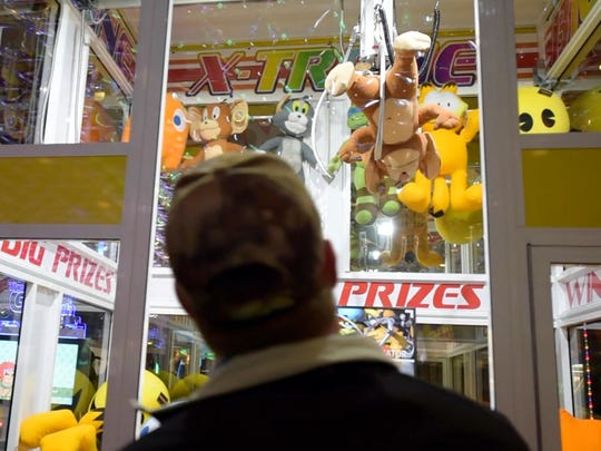 Steve Coltra plays the X-Treme claw game at Peppermill Reno arcade Jan. 10, 2017