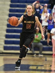 McAuley's Hallie Heidemann pushes the ball up the floor.