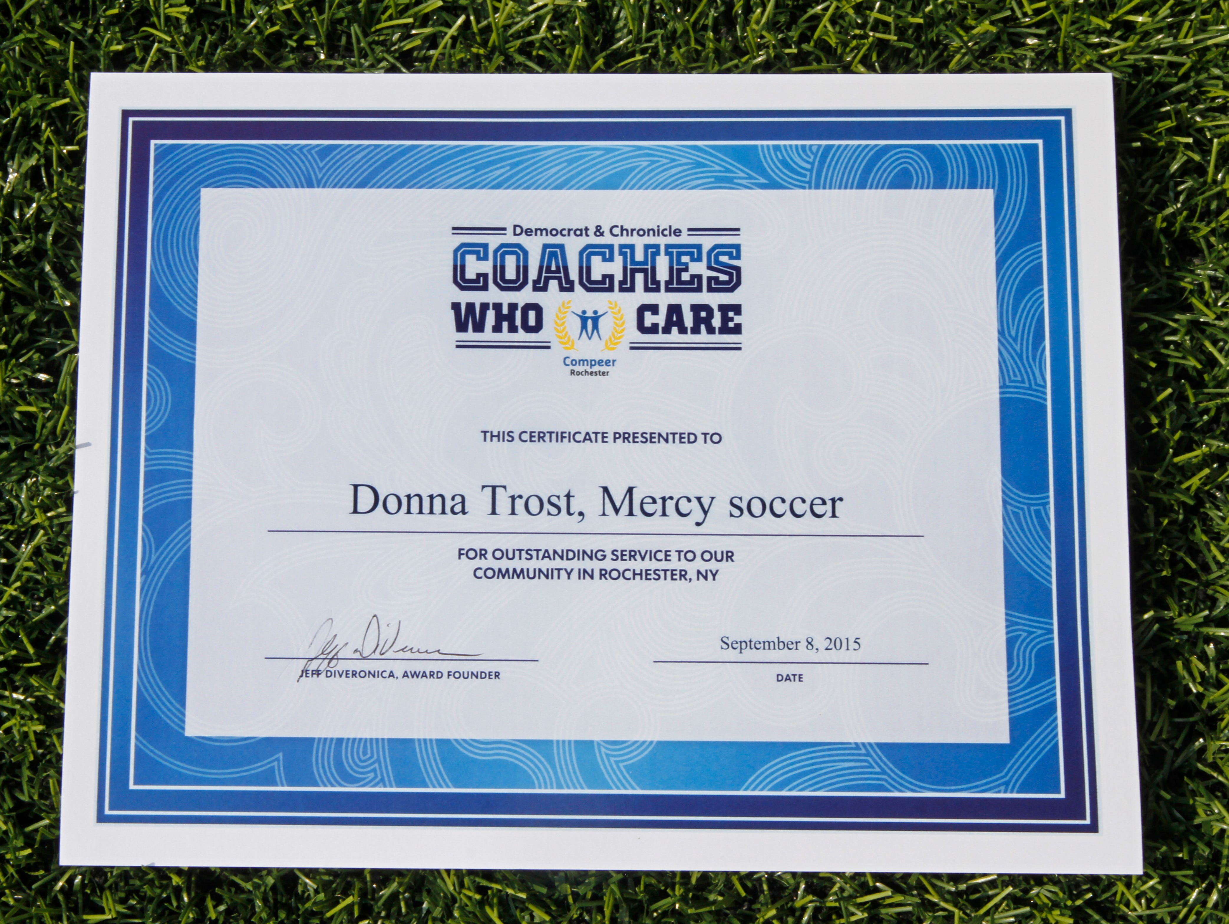 Donna Trost, head coach of Mercy varsity girls soccer, is the latest winner of the Democrat & Chronicle Coaches Who Care award, given to her Tuesday, Sept. 8, 2015 in Brighton.