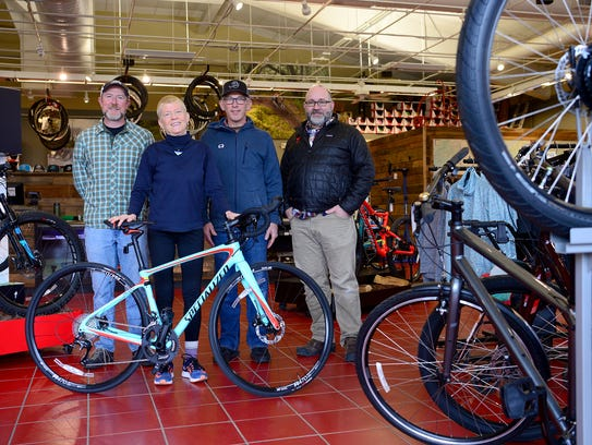Ginny Oman poses with Motion Makers Bicycle Shop manager
