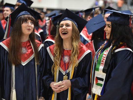 Graduating with High Honors, (from left) Megan McGeough,