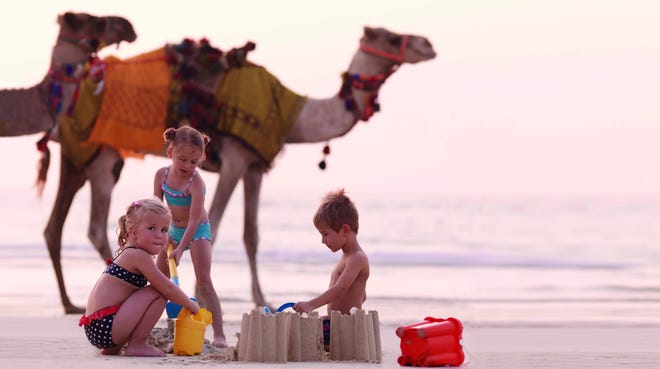 The Ritz-Carlton's new programs for children include adventures such as this encounter with camels in Dubai.